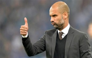 Bayern head coach Pep Guardiola of Spain gestures during the German soccer Bundesliga match between FC Schalke 04 and Bayern Munich at the arena in Gelsenkirchen, Germany, Saturday, Sept. 21, 2013. Schalke was defeated by Bayern with 0-4. (AP Photo/Martin Meissner)